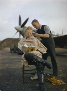 An Royal Air Force pilot getting a haircut during a break between missions, Britain, 1942